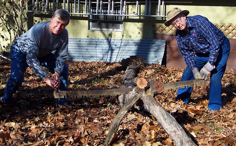 This is the two-man crosscut saw my dad and I used to cut LOTS of firewood as I was growing up. See the saw?