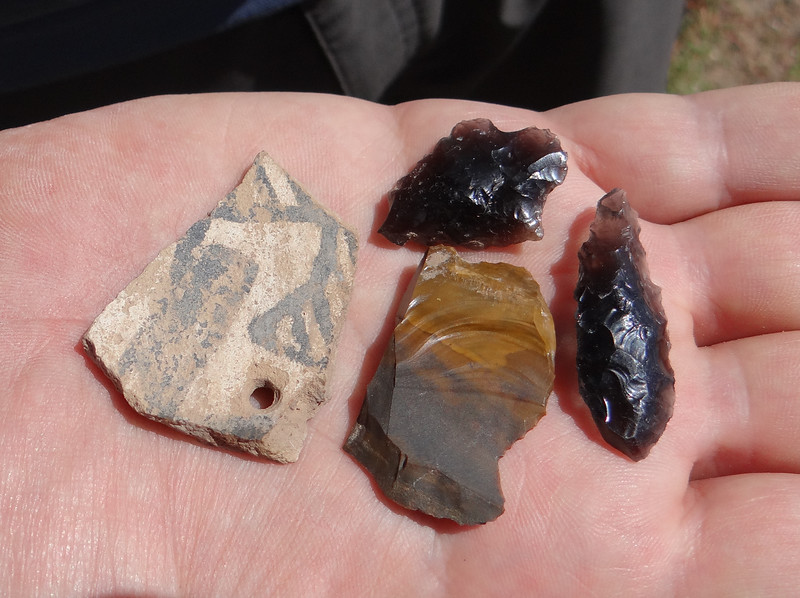 Found in the same place- obsidian points; flint scraper; shard with hole, perhaps for hanging the pot over a fire.