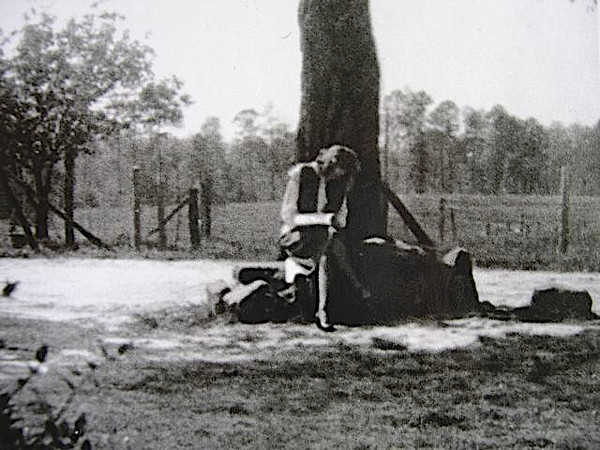 This is my mom writing a letter to my dad when he was fighting in the Battle of the Bulge. This is at the foot of an oak tree in his parents' front yard near Albertville, AL.