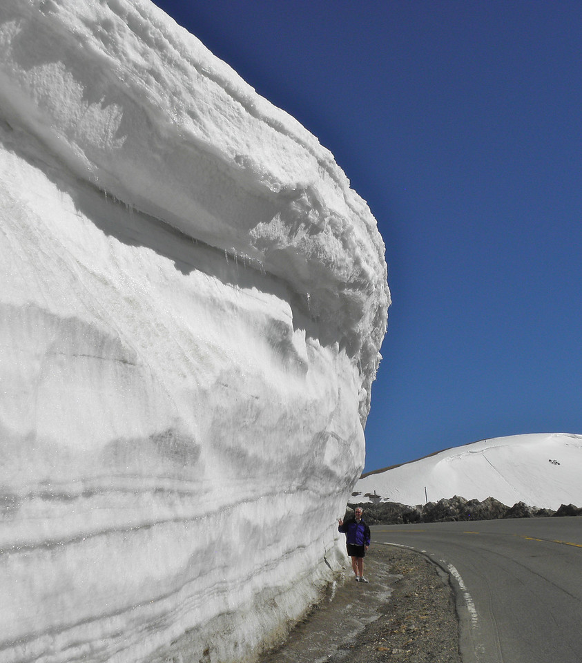 Ross giving scale to the snow accumulation on Loveland Pass. This was June 6, after a lot had already melted.