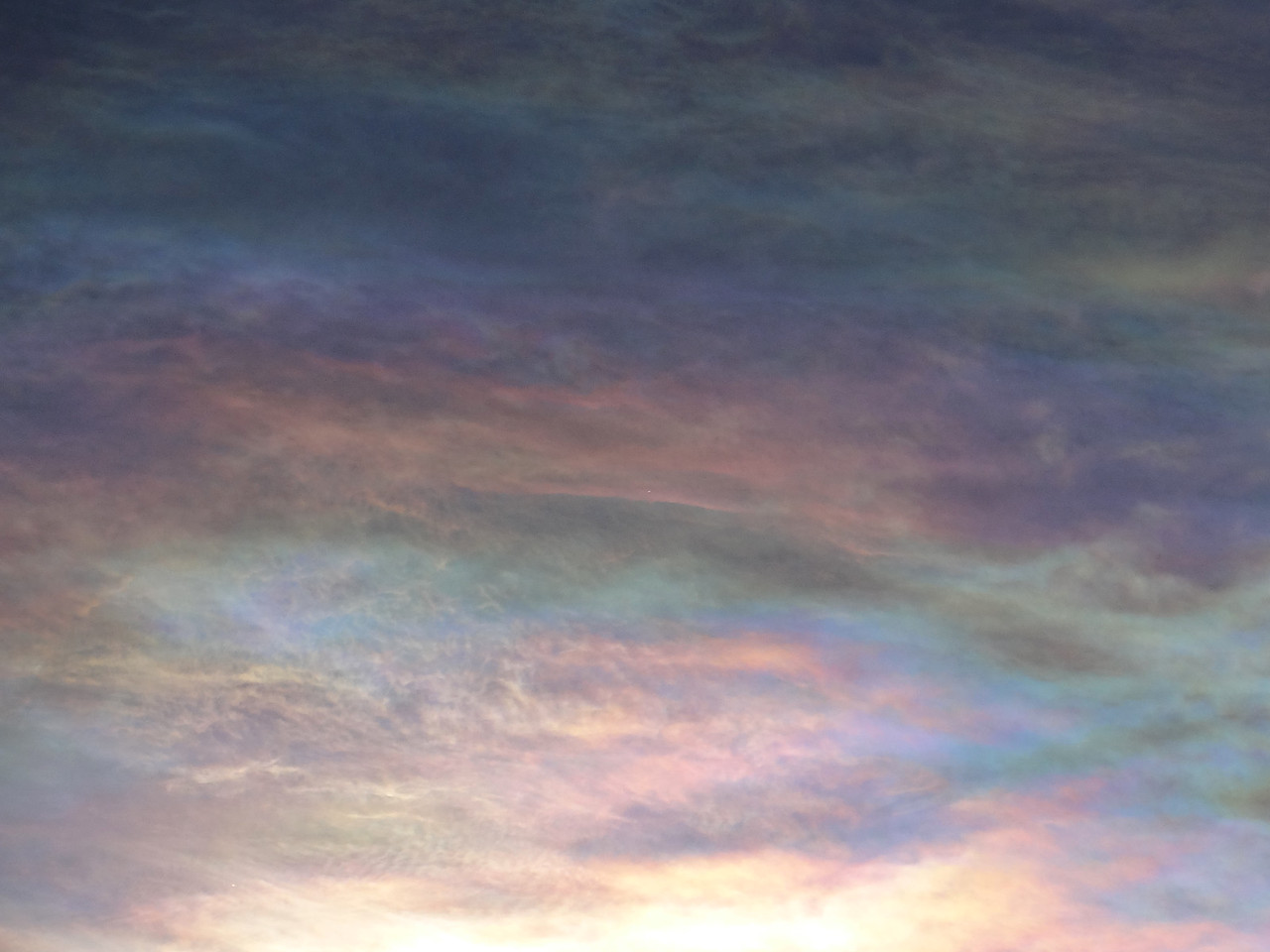 If you've never seen iridescence in a cloud, a photo of it can look quite unbelievable.