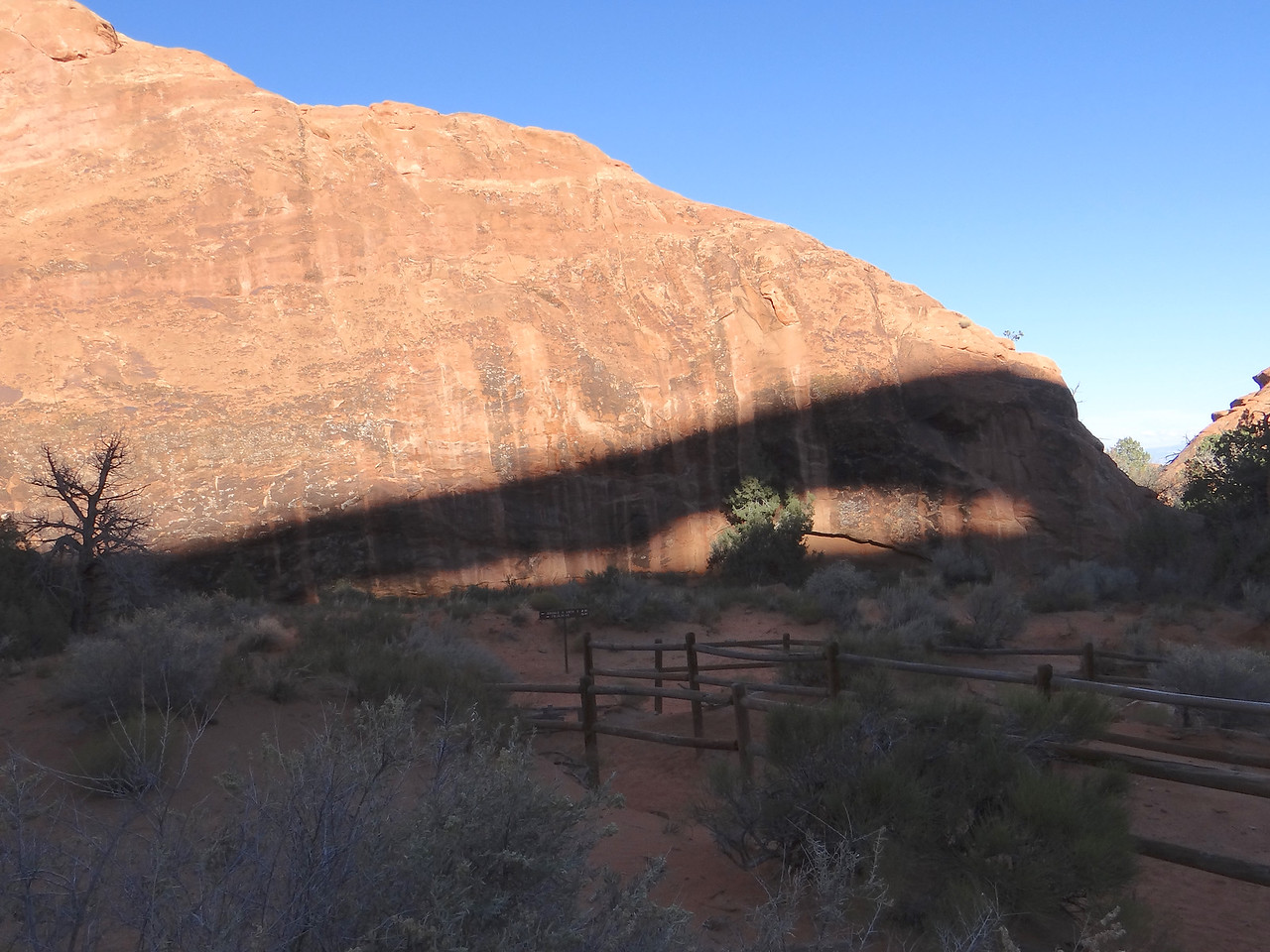 The shadow of 280 ft long Landscape Arch in Arches Natl Park.