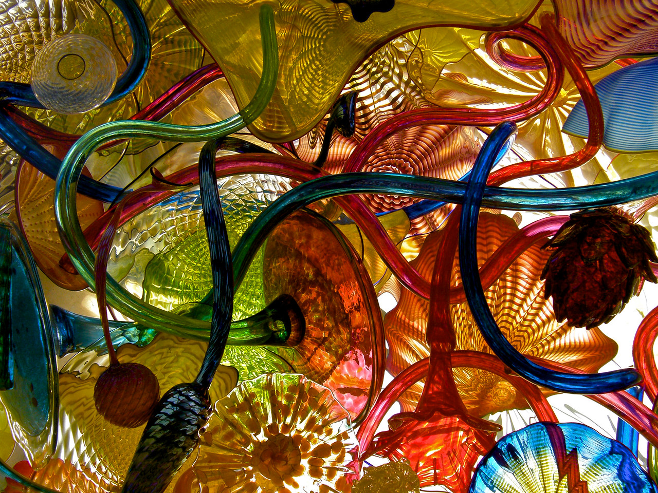 No glass artist is more famouser than Dale Chihuly. He and Sarah are alums of the U of Puget Sound, dontcha know. This is in the ceiling of one of eight galleries at the Chihuly Glass Museum in Seattle.