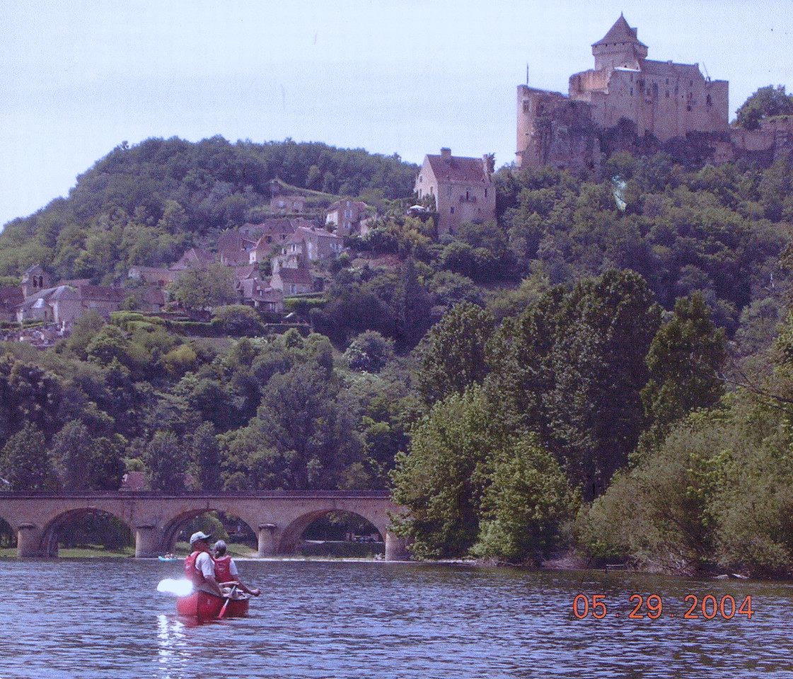 A beautiful, jet-setting couple cruising down a river in France, followed closely by their adoring daughters