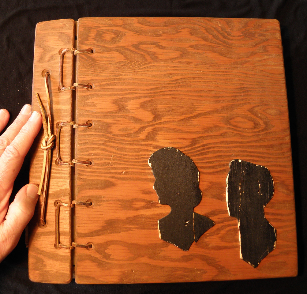"When I was 16, I spent many afternoons in the basement workshop at Roger Golden's house, making this ""thank you"" book for my folks as a Christmas present.  Those are, or were, their silhouettes cut from balsa wood."