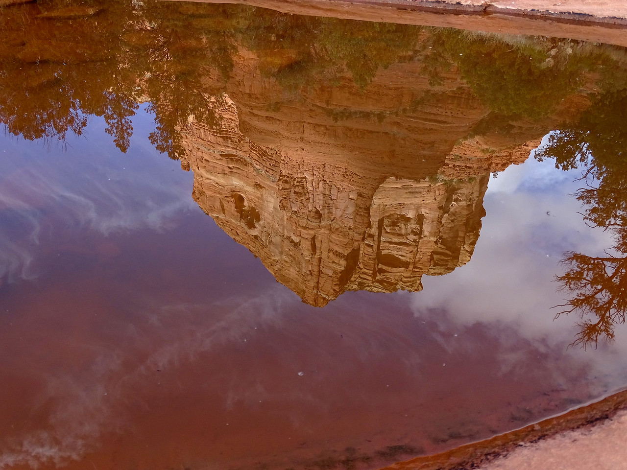 Arroyo puddle reflecting Court House Rock