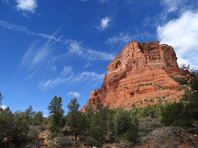 Red rocks, deep blue sky, white clouds