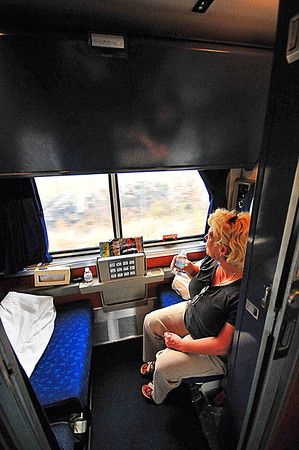 "This is Linda in our sleeper cabin on the AmTrak ""Empire Builder"" out of Chicago. We rode this train to Shelby, Montana en route to the Canadian Rockies."