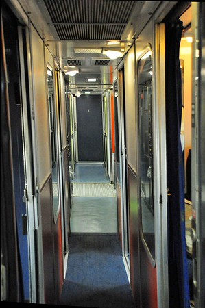 This is the passageway through the upper deck of our sleeper car. Lucky the walls are close because the train shakes and sways quite a bit. Some folks bounce off the walls like pinballs trying to navigate to the dining car. Another way it was like a Navy ship!