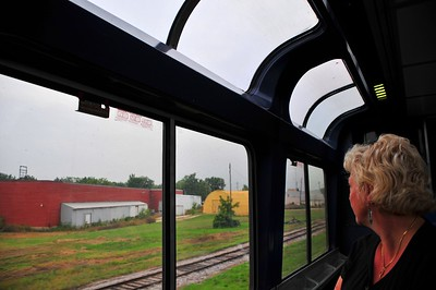 Linda is watching the scenery go by in the Amtrak Empire Builder observation car. It goes through more industry than scenery - seems like we got to see how a large number of businesses like to store rotting metal stuff by the railroad tracks.