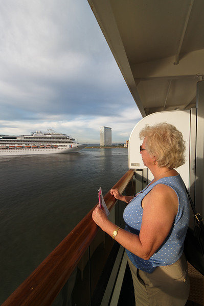 Linda watching the sea and anchor detail on the Oosterdam.