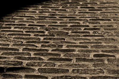 Cobblestone street detail from Old Montreal, next to the Notre Dame Cathedral.