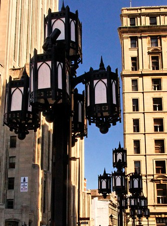 Shot above the construction and fences to get these old street lights in front of the Montreal Notre Dame Cathedral.