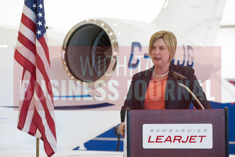 Tonya Sudduth, general manager of Learjet Programs and Wichita Site, Bombardier Business Aircraft, remarks on the significance of the Learjet 75 program reaching 75 deliveries in two years Wednesday afternoon at the Bombardier Learjet facility in Wichita.