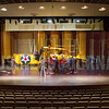 Wichita State University moves the Kansas Aviation Museum's 1934 NS-1 Stearman Model 73 Navy trainer onto the stage of Miller Concert Hall, where it served as the backdrop for a concert.