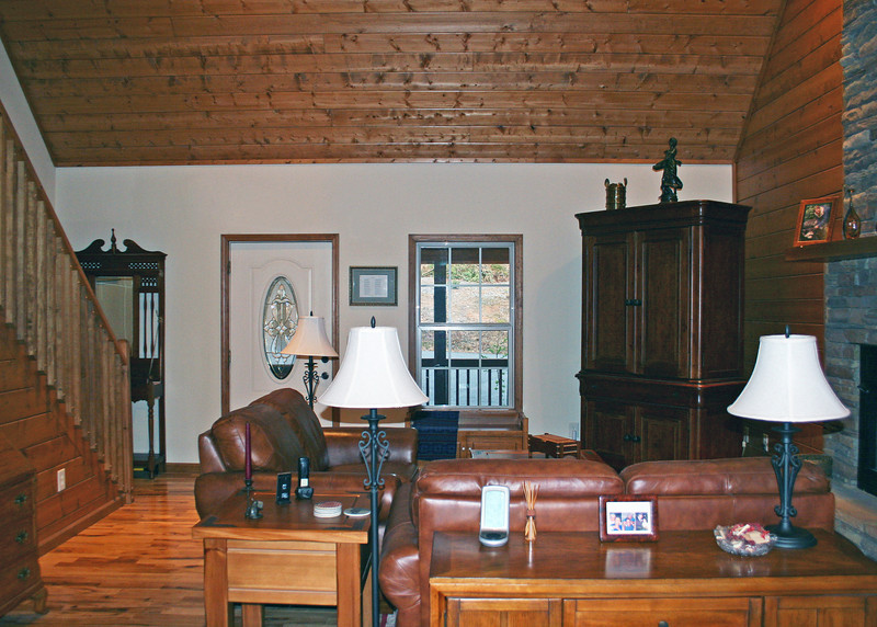 View of living room from dining room showing the front door.