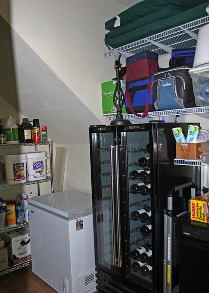 We  built a huge pantry in the basement.  As you go down the stairs into the finished basement, the pantry is on the right.  It is large enough to hold a refrigerator, small chest freezer, 100 bottle wine cooler, trash compactor and lots of shelves.