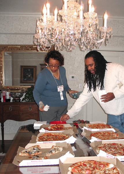 Kayla Jackson and participant enjoying pizza