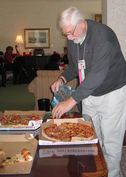 Mike enjoying pizza