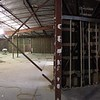 Remove all interior walls, plumbing, electrical and architecture down to structural elements