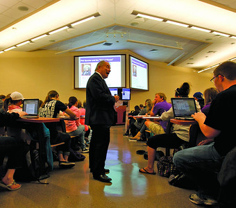 A record 24,378 students enrolled at K-State in fall 2012, filling classrooms. Steven Smethers, associate professor of journalism and digital media, leads a class in Umberger Hall. (Photo by Allen Eyestone)