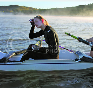 K-State was the second Big 12 university to add women's rowing as a varsity sport. Erin Roeser takes a break during practice on Tuttle Creek Reservoir. (Photo by Justin Hayworth)