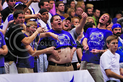 Varsity sports draw crowds clad in purple. At a volleyball game in Ahearn Fieldhouse, Patrick Marks, senior in geography, shakes his stomach in hopes of distracting the Iowa State server. (Photo by Steven Dearinger)