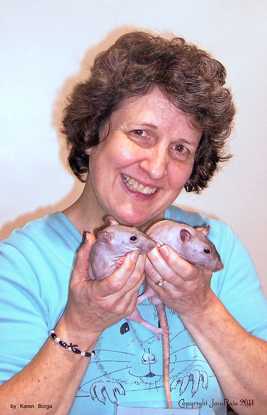 Debbie Ducommun flashes a big smile with her sweet hairless rats, One and Two. Taken in February 2011, at Pet Expo, in Maryland, by Karen Borga.