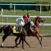 Victor Santiago aboard Fu Pegs Baby in the 7th race