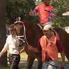 Rajiv Maragh gesturing while parading in the paddock. He is aboard Defarge.