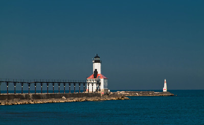 The Michigan City East Pierhead Lighthouse, built in 1904 of a steel frame clad in cast iron plates.  It replaced the original, built in 1871.  The catwalk allowed access to and from the lighthouse when severe weather created high waves.