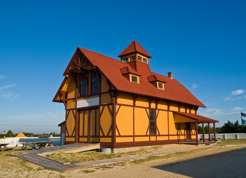 The Indian River Life-Saving Station, built in 1876 by the US Life-Saving Service.  One of the few originals remaining, it has withstood more than 130 years of assault from Atlantic Ocean storms.<br /> <br /> The Stations along the Delmarva penninsula were each painted a different color palette, so that mariners sailing along the coast could more easily determine their location.  These Life-Saving Stations were set up much like modern fire stations: equipment storage behind the large doors, surrounded by living quarters to the side and above.