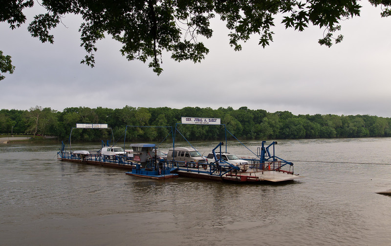 "It is a ""cable-stayed"" ferry - it moves along a steel cable across the river, powered by the blue boat you see here.  The rope that originally guided the ferry was replaced by a metal cable in 1872."