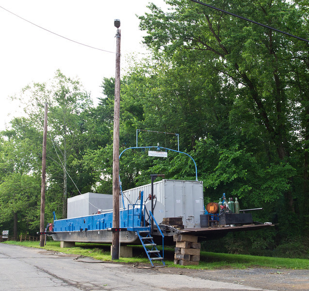 This is the previous 15 car ferry.  If severe Potomac River flooding is imminent, the refrigeration and cooking equipment is moved out of the building and onto this ferry, which can float up and down the two large poles you see here, thus protecting the equipment.