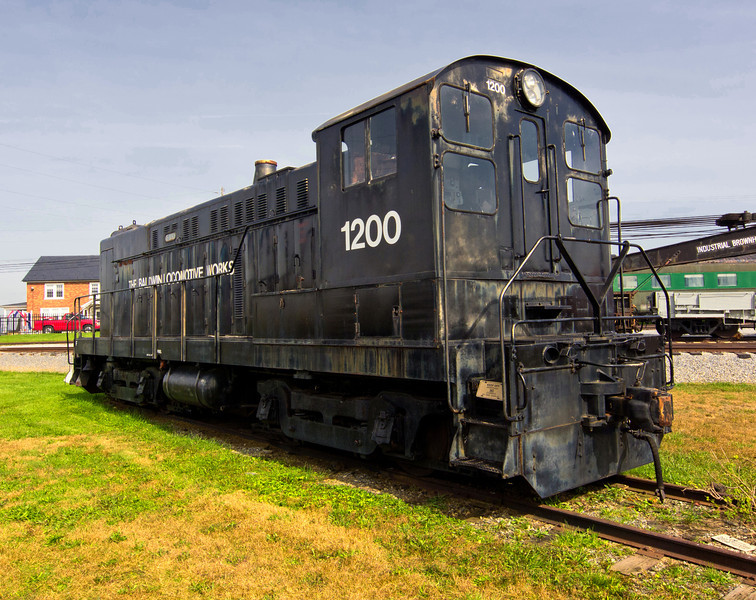 Baldwin Locomotive Works #1200, a Baldwin S-12, built in 1951<br /> <br /> I didn't know that the Baldwin Locomotive Works, one of the major builders of steam locomotives in the US, also built diesel-electric locomotives.  In fact it turns out they didn't last long in that market.  Their small switcher diesel-electric locomotives (like this one) were well regarded but they weren't able to produce a reliable prime mover. They stopped locomotive production in 1956.
