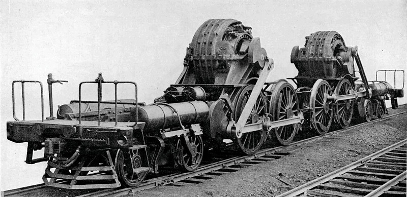 The running gear for a Juniata DD-1 electric locomotive.  Note that in the early stages of electric locomotive design, the running gear was an evolution of a steam locomotive.<br /> <br /> (Image from the 1922 Locomotive Cyclopedia of American Practice which is now in the public domain.)