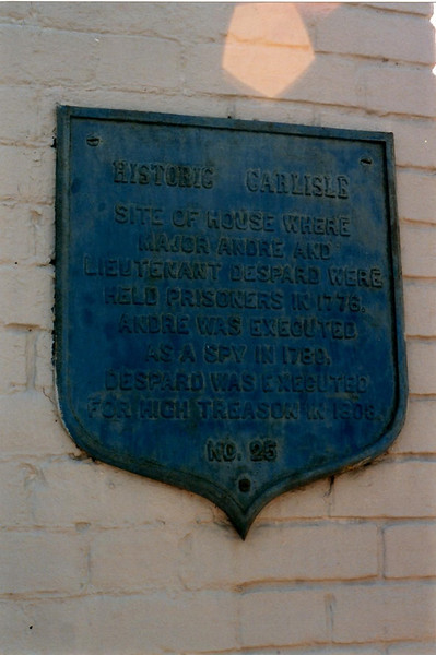Plaque on the present building on the site