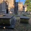 """View of the two Andre family """"chest tombs"""" (in the foreground) which will help you locate them in the cemetery. In the left rear of the photo is the church's bell tower. The path one would follow from the gate can be seen near the church. You would approach from the right in this photo. In the church records, these graves are designated as plots A-55 and A-56."""