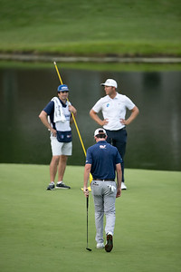 postman misses a putt to win the championship while power looks the other way