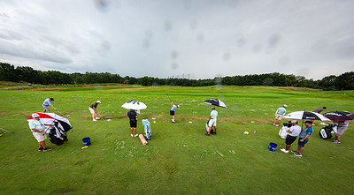 Players on the range during a prctice round 7.13.21