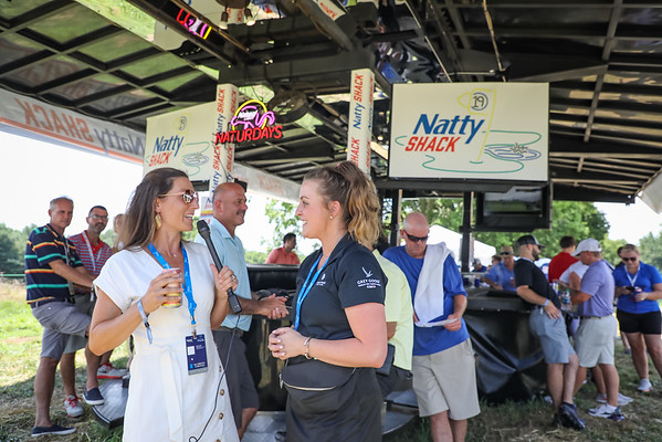 Interviewing the server on the activities at the Natty Shack.