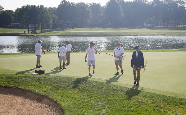 Grounds crew and tour officials set up hole locations on #9.  7.19.19