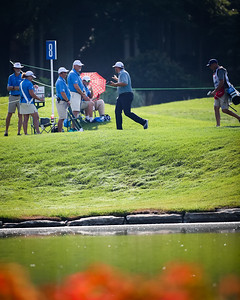"""Cullan Brown waves to the volunteers on 8 green after making a 1'11"""" birdie putt."""