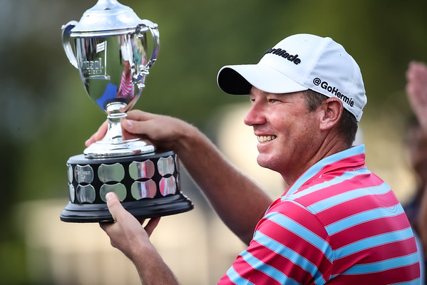 Jim Herman with the Barbasol Trophy