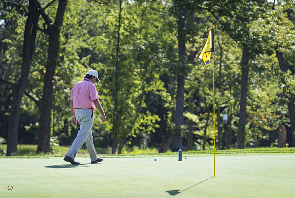 A PGA Tour official evaluates possible hole locations on #16.