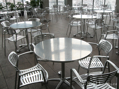 Chrome Chairs and Tables. Cafeteria tables and chairs in silver chrome. National Gallery of Canada, Ottawa, Ontario.  © Rob Huntley