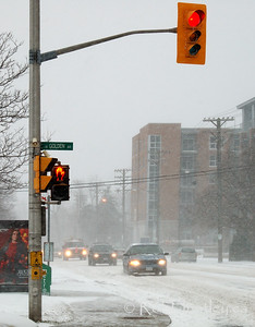 Traffic during the first snowstorm of the season. This is at the corner of Richmond Road and Golden Avenue in Ottawa, Ontario. © Rob Huntley