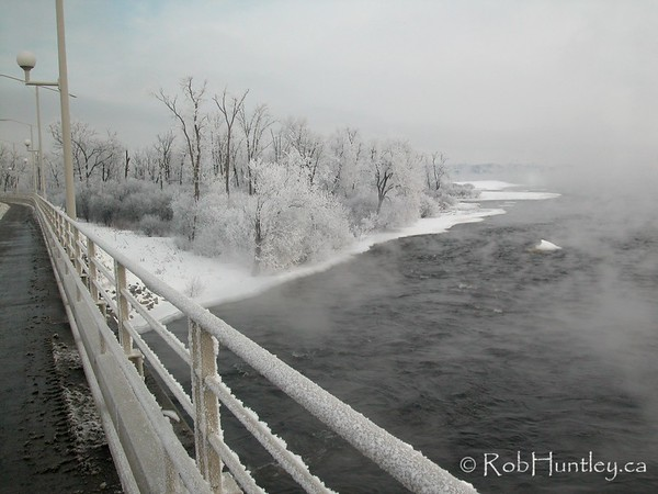 Champlain Bridge in Ottawa, Ontario, Canada on a cold winter day with hoarfrost on the railings and trees. Yes, this is a colour photograph! © Rob Huntley
