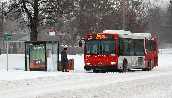Person boarding an OC Transpo bus on Richmond Road at Broadview Avenue in Ottawa. This is during our first winter snowstorm of the season. © Rob Huntley