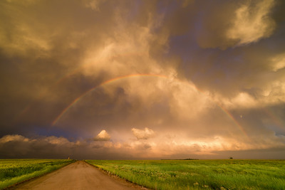 A spectacular sunset and pair of rainbows east of Dodge City, KS, contrast with the damaging tornadoes that had just ravaged the area an hour earlier on May 24, 2016.
